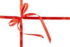 Curva vermelha fina com a fita cruzada, isolada no fundo branco Imagens de Stock Royalty Free