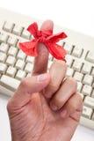 Curva vermelha no dedo Fotografia de Stock Royalty Free