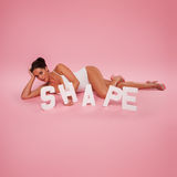 Curvaceous woman with text SHAPE Royalty Free Stock Photography