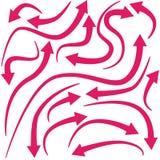 Curvar flechas rojas Imagen de archivo libre de regalías