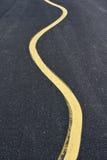 Curvar la línea amarilla Imagen de archivo libre de regalías