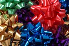 Curvas coloridas do Natal que dão forma a um fundo vívido Fotos de Stock Royalty Free