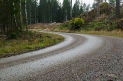 Curvatura della strada della ghiaia Fotografie Stock