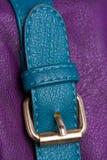 Curvatura dourada na correia azul Imagens de Stock Royalty Free