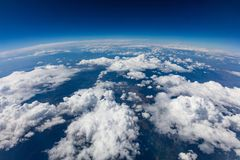 Curvature of planet earth. Aerial shot. Blue sky and clouds. Over land royalty free stock photography