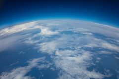 Curvature of planet earth. Aerial shot. Curvature of planet earth. Aerial shot over clouds royalty free stock images