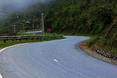 The curvature of the road in the mountains. stock photos