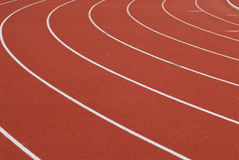 On the curve. Track lanes on a a rece course. The track is orange Stock Image