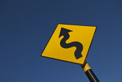 Curve ahead. Road sign on blue sky background stock image
