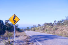 Curve ahead traffic sign. On blue sky royalty free stock photos