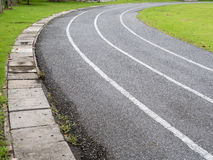 Curve asphalt running track with lawn. Curve asphalt running track in a local stadium with lawn beside, asia, thailand Stock Photography