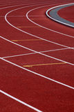 Curve athletics running track. Stadium running track royalty free stock images