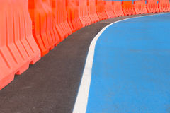 Curve bike lane and orange barrier. Stock Photos