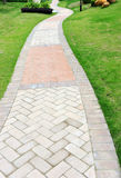 Curve brick path in garden Royalty Free Stock Photos