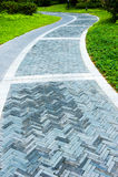 Curve brick path in garden Stock Photo