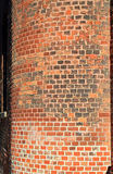 Curve in brick wall Stock Images