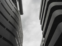 Curve building shape. Monochrome of building curve shape and cloudy sky royalty free stock photography