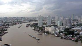 Curve of Chao Phraya River, Bangkok City, Thailand. Curve of Chao Phraya River with white sky, Bangkok City, Thailand stock video footage