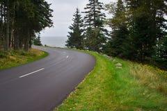 Curve in coastal roadway Stock Photo