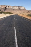 Curve in Country Asphalt Road with Mountain in Bac Royalty Free Stock Images
