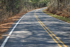 A  curve  in  a  road. A  curve  in  a  ctree  lined  ountry  road Stock Photography