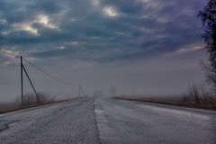 Curve In The Fog. A country road curve on a very foggy night in the rural Finland Stock Photography