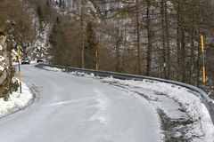 Curve of a frozen mountain road in winter Royalty Free Stock Images
