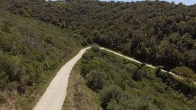 Curve hairpin in the mountains seen from above with the drone stock video