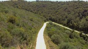 Curve hairpin in the mountains seen from above with the drone stock video footage