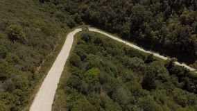 Curve hairpin in the mountains seen from above with the drone stock footage