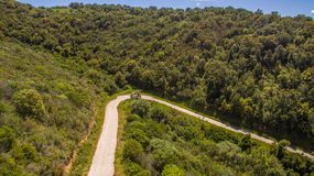 Curve hairpin in the mountains seen from above with the drone royalty free stock images