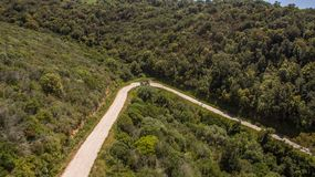 Curve hairpin in the mountains seen from above with the drone royalty free stock image