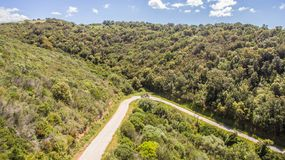 Curve hairpin in the mountains seen from above with the drone royalty free stock photography