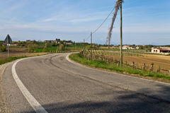 The curve on the hill. Road curve in field on the hill Stock Image