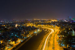 Curve of Ho Chi Minh Riverside cityscape night view with Ben Nghe or Tau Hu canal and calmet Bridge in sunrise or sunset Stock Photography