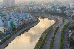 Curve of Ho Chi Minh Riverside cityscape night view with Ben Nghe or Tau Hu canal and calmet Bridge in sunrise or sunset Royalty Free Stock Photos