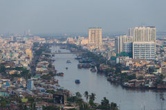 Curve of Ho Chi Minh Riverside cityscape night view with Ben Nghe or Tau Hu canal and calmet Bridge in sunrise or sunset Royalty Free Stock Image