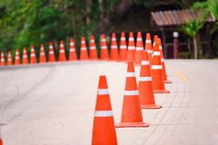 Curve line of orange traffic cone on the road at the Pa Hin Ngam Royalty Free Stock Images