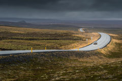 Curve line road with lonely car in Autumn season. In cloudy day stock images