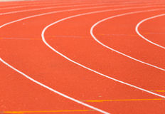 Curve line on running track. Curve line on red running track royalty free stock photography