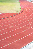 Curve and line on running track with texture rubber cover Stock Images