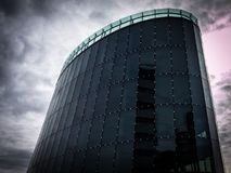 The curve. Modern office building in Amsterdam stock photography