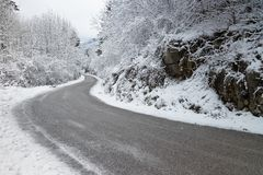A curve in the mountains during winter Stock Photos