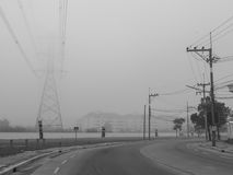 The curve path out of the fog,. The road to run away from the cloud of fog, time to escape the zombie Stock Photo