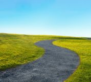 Curve path in s-shape. And blue sky stock photography