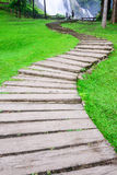 Curve pathway through green lawn Royalty Free Stock Photography