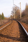 Curve rail track electric pylons Stock Images