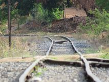 A a curve in the railroad. Rail transport is the transfer of persons or goods, between two geographically separated locations, by a train, motor vehicle or other royalty free stock photography