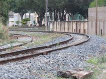A a curve in the railroad. Rail transport is the transfer of persons or goods, between two geographically separated locations, by a train, motor vehicle or other stock photos
