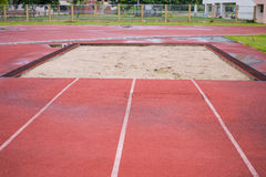 Curve of a Red jump Running Track. Sand royalty free stock images